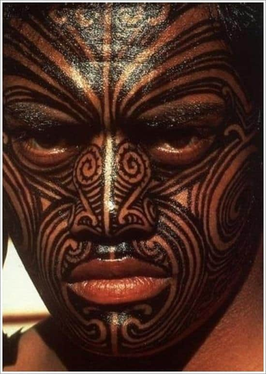 man with face tattoo