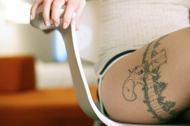 garter belt tattoo on upper leg