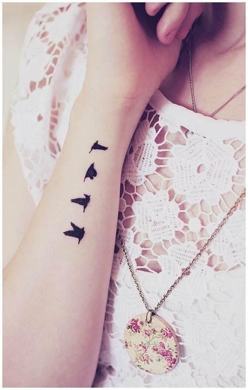 Flying Bird Tattoos on Arm