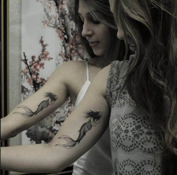 Matching mermaid sister tattoos by Marquinho Andre
