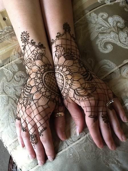 Henna cum lace tattoo designs.