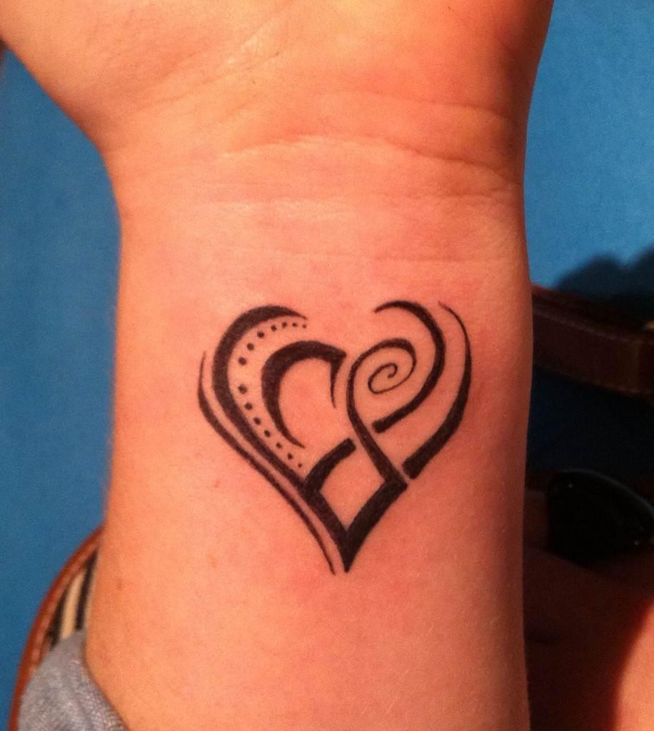 Tribal Heart Tattoos on Hand