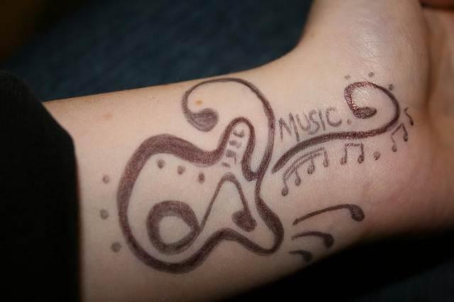 Cool Music Tattoo Design