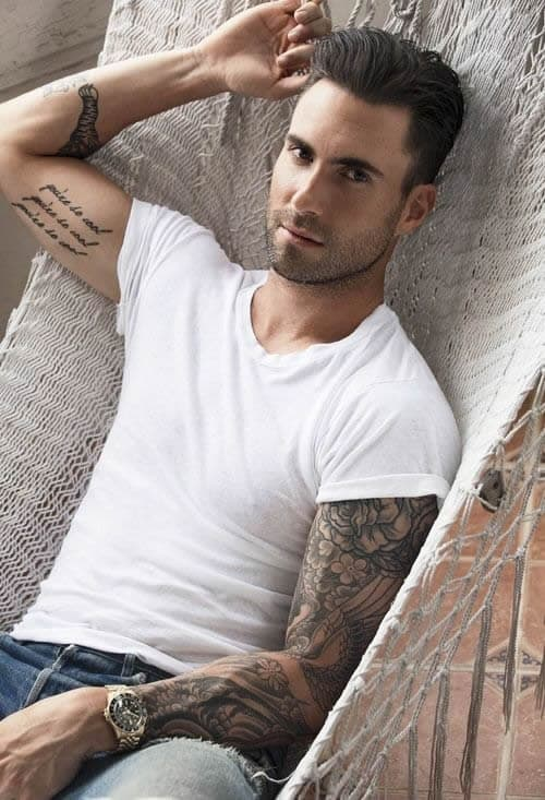 adam levine cursive tattoo