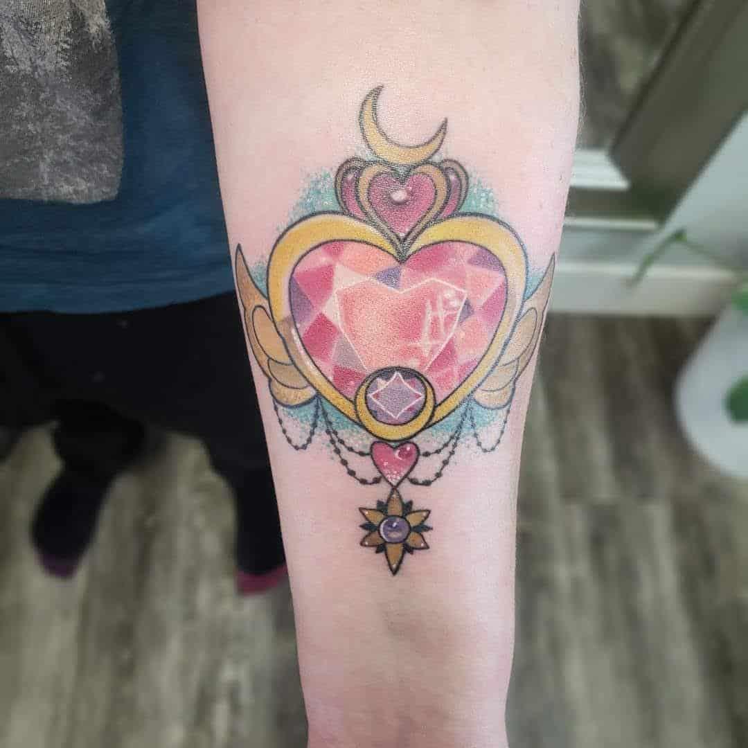 sailor moon locket tattoo on arm