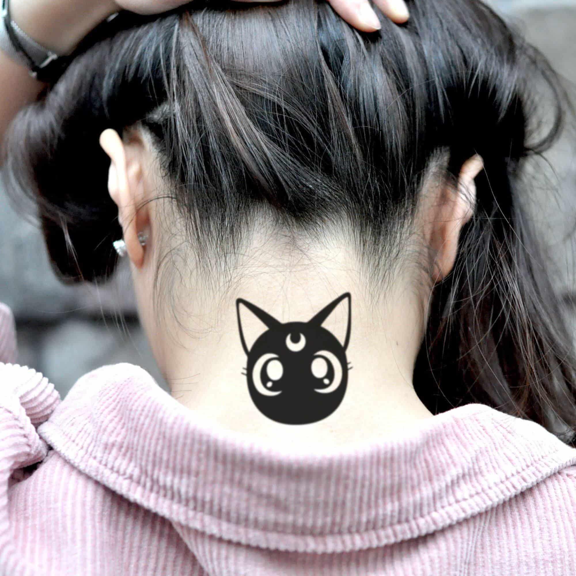 luna sailor moon tattoo on neck