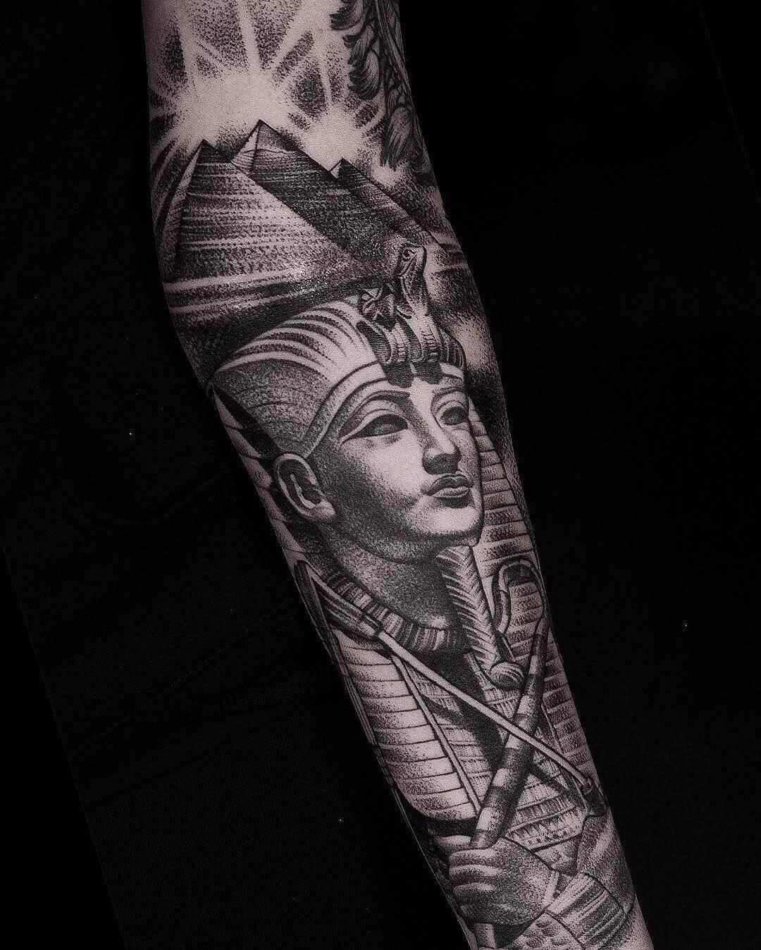dotwork egyptian tattoo on arm