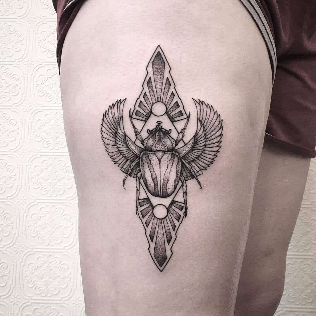 geometric egyptian tattoo on thigh