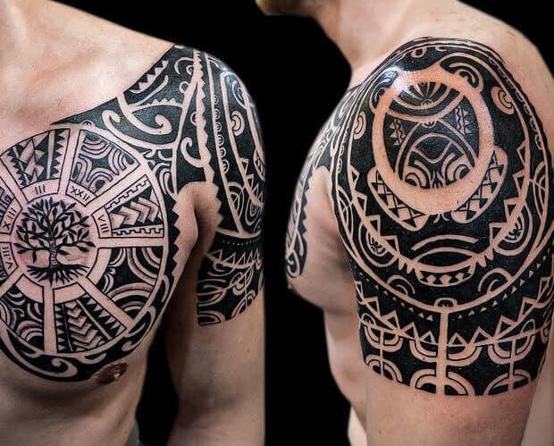 tribal egyptian tattoo on arm