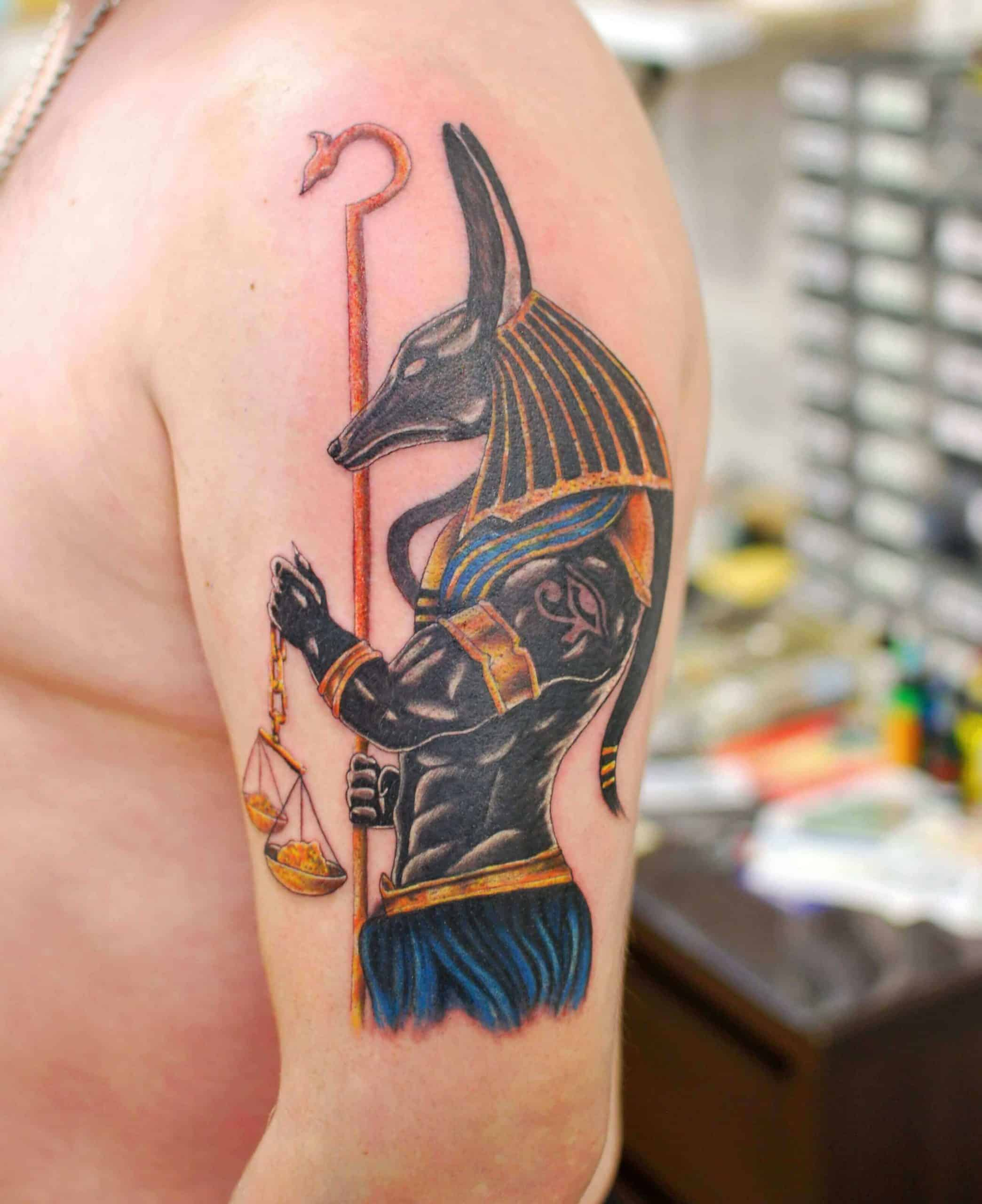 colored egyptian tattoo on arm