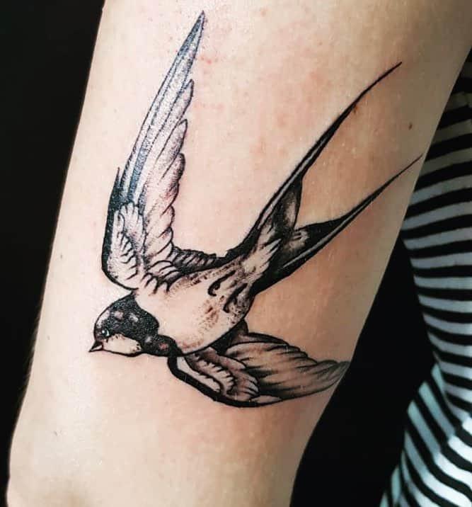 sailor jerry sparrow tattoo on arm