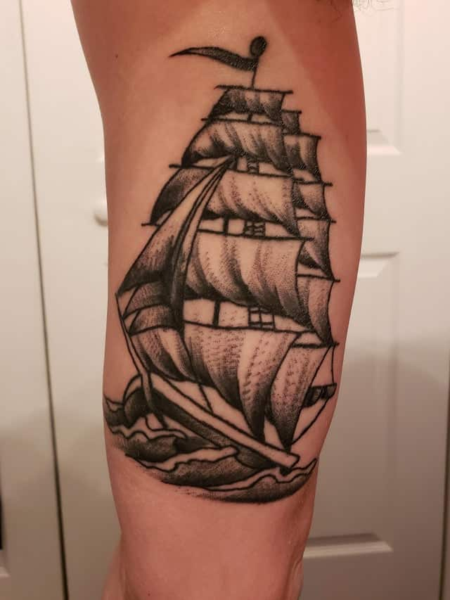sailor jerry ship tattoo on arm