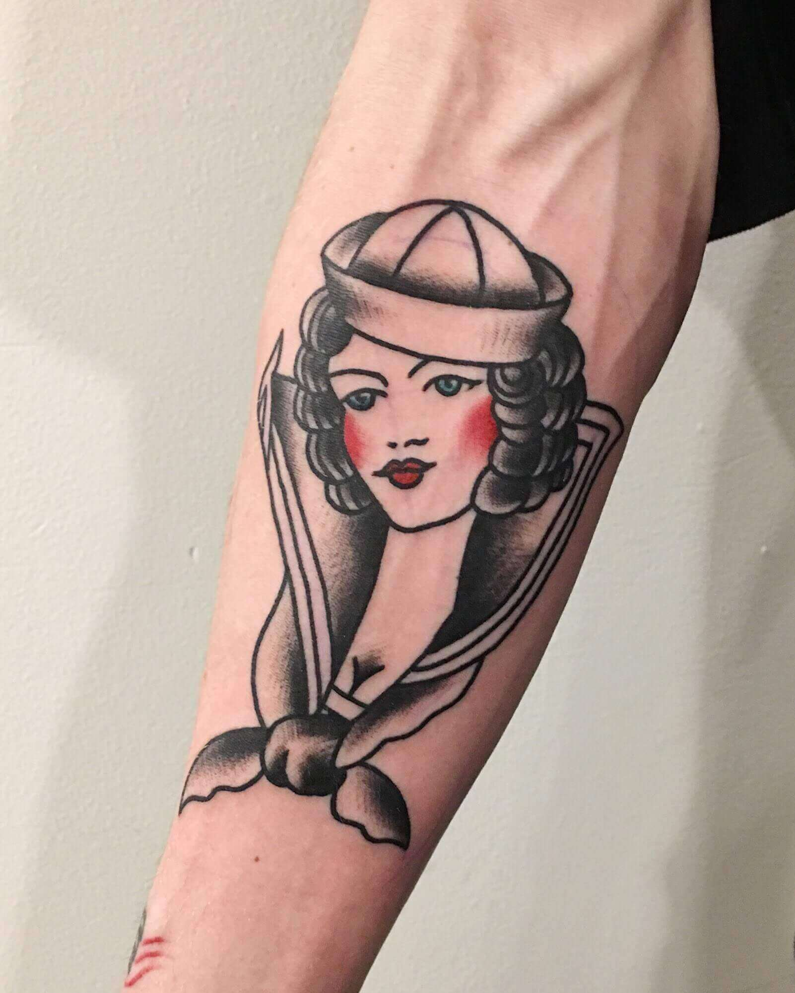 sailor jerry pinup tattoo on arm
