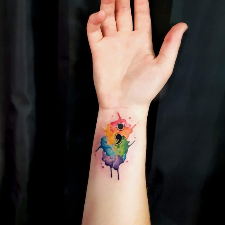watercolor semicolon tattoo on wrist