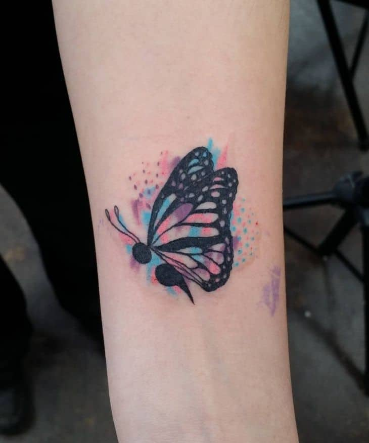 butterfly semicolon arm tattoo