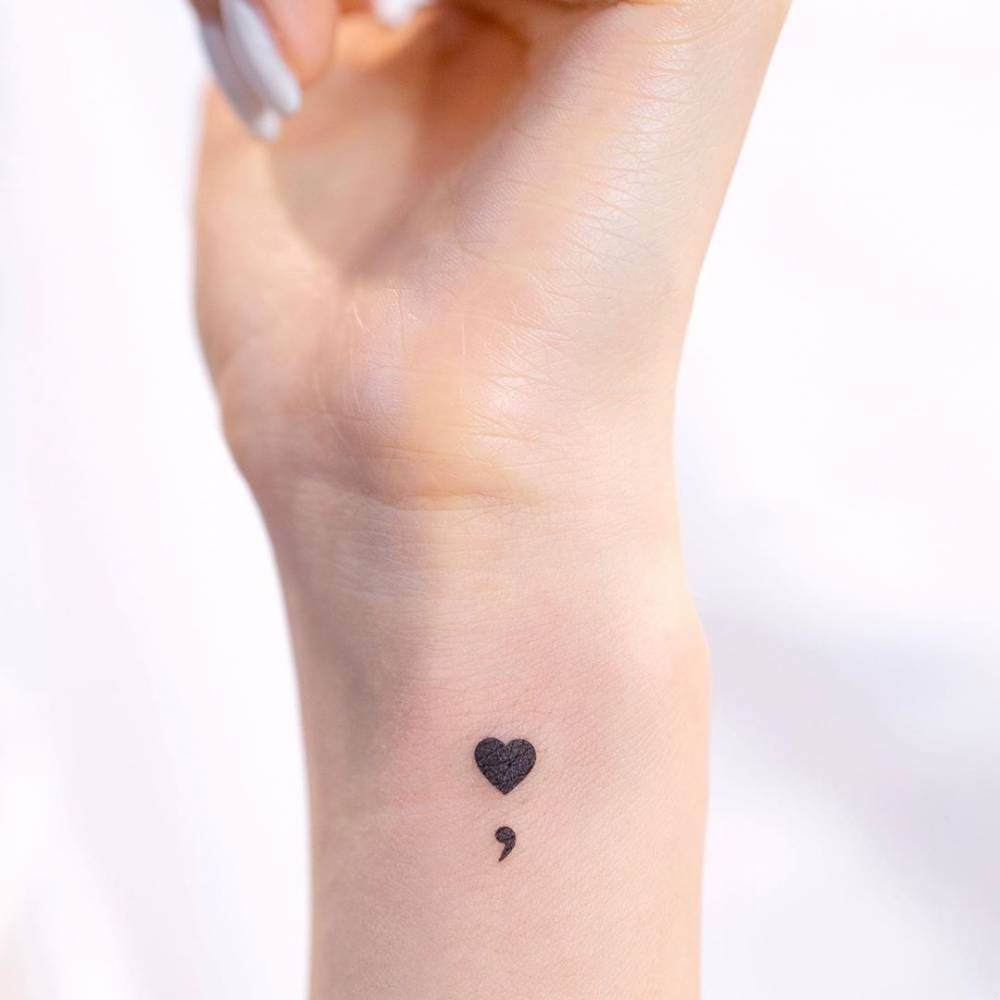 heart semicolon tattoo on wrist