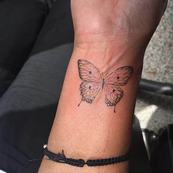 butterfly semicolon tattoo on wrist