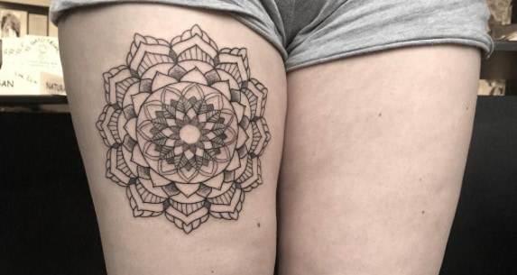Mandala flower on thigh by Poppy Segger