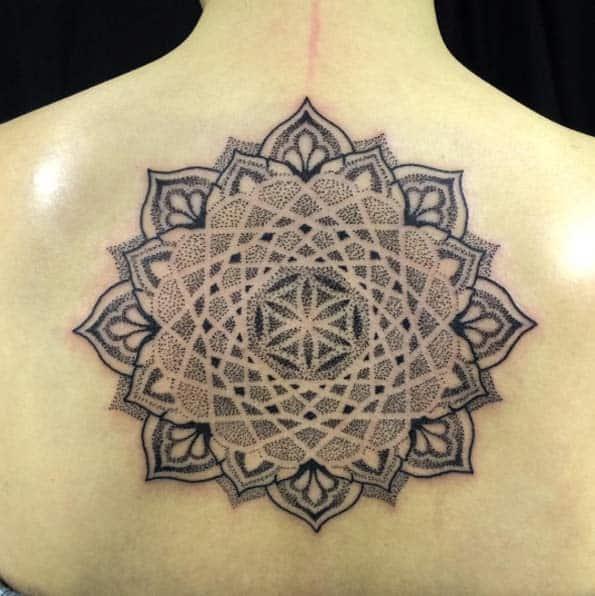 mandala tattoo on middle of back