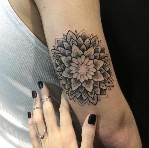 mandala tattoo on back of arm