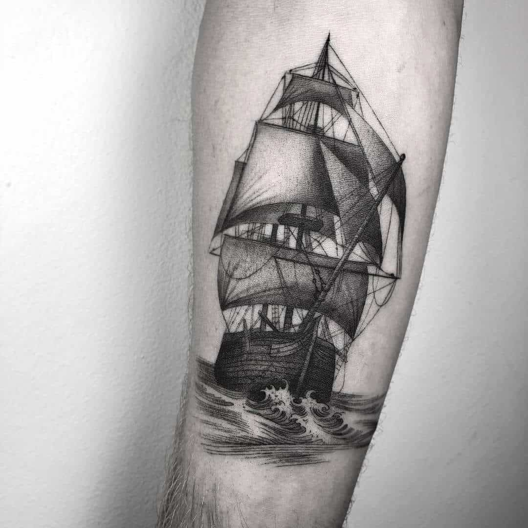 boat tattoo on arm
