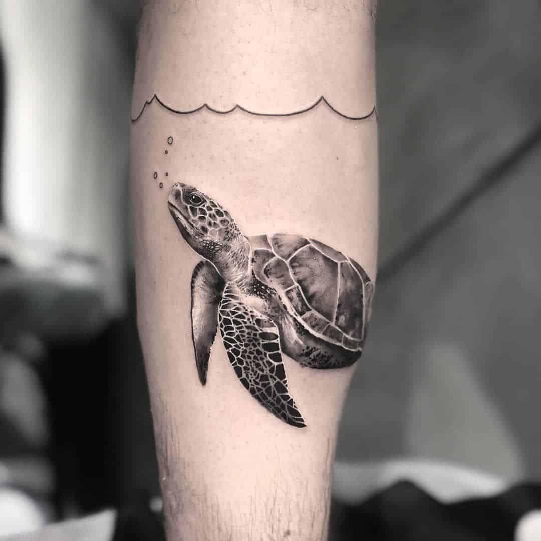 sea creature arm tattoo