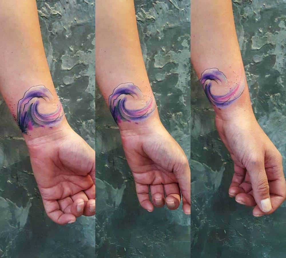 watercolor ocean tattoo on wrist