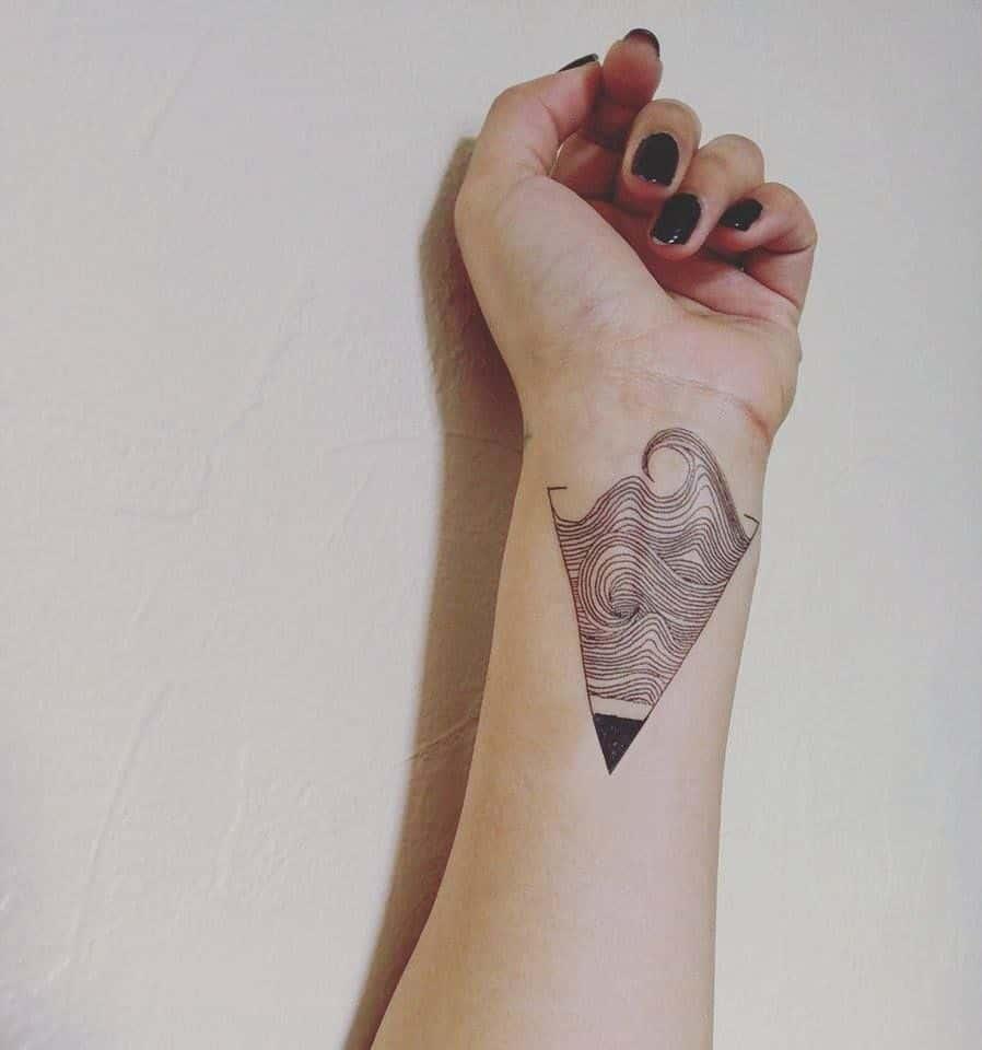 geometric ocean tattoo on wrist