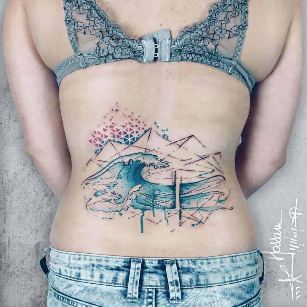 geometric ocean tattoo on back