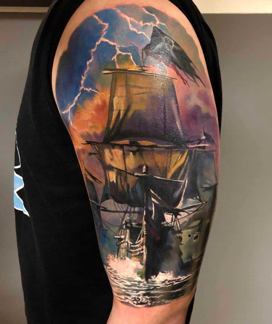 watercolor boat tattoo on arm