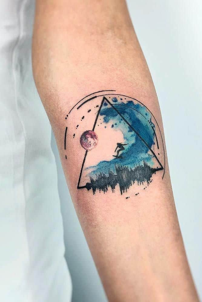 watercolor ocean tattoo on arm