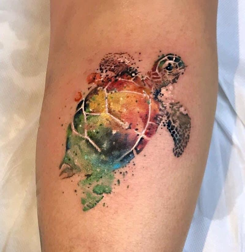 watercolor sea creature tattoo on arm