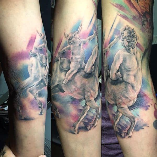 colored sagittarius tattoo on arm