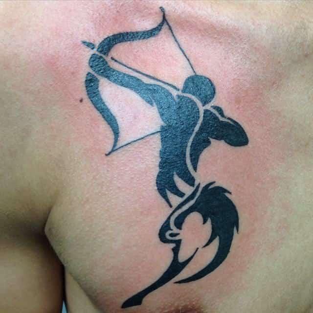 tribal sagittarius tattoo on chest
