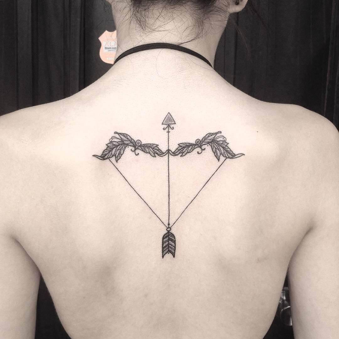 arrow sagittarius tattoo on back