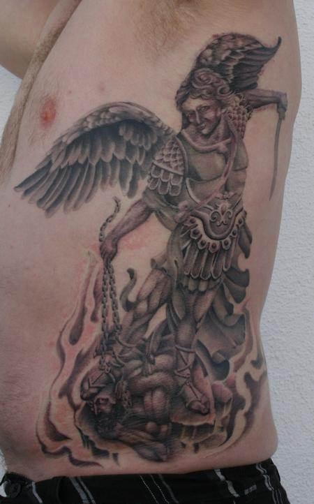 saint michael rib tattoo
