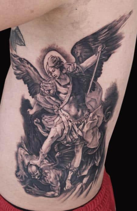saint michael tattoo on rib