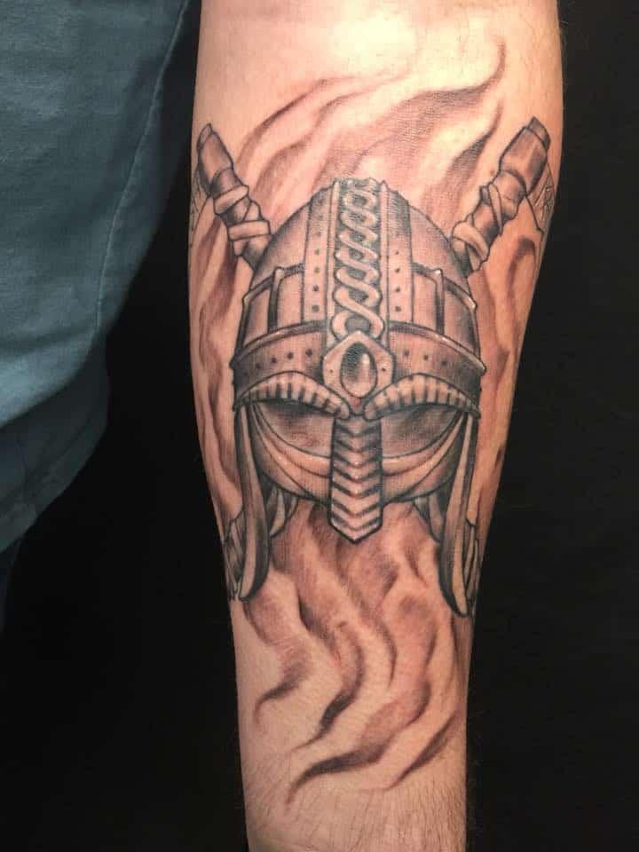 viking helmet tattoo on arm