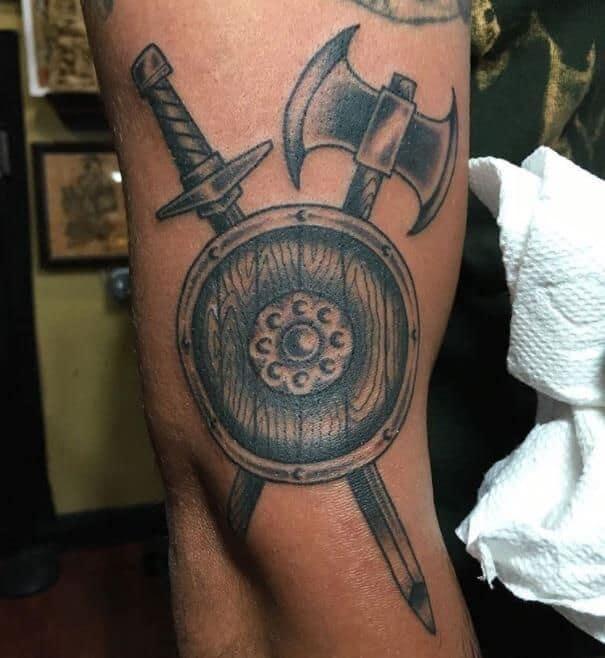 viking shield tattoo on arm