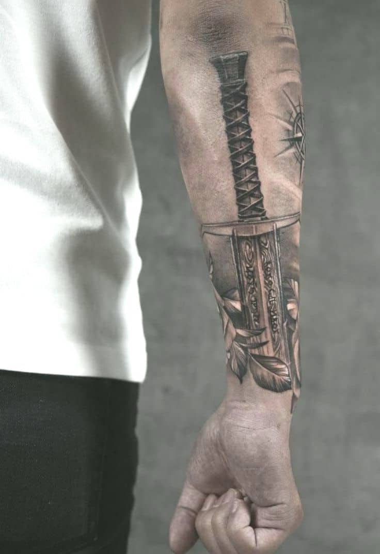 viking sword tattoo on arm