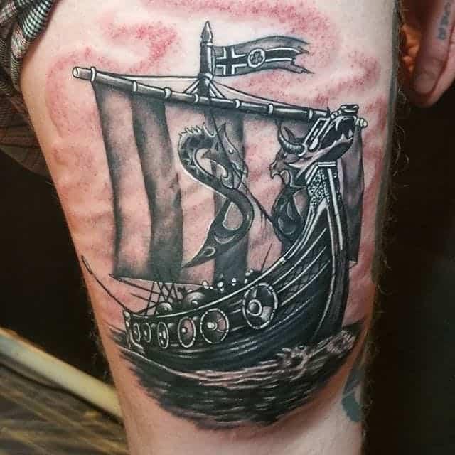 viking ship thigh tattoo