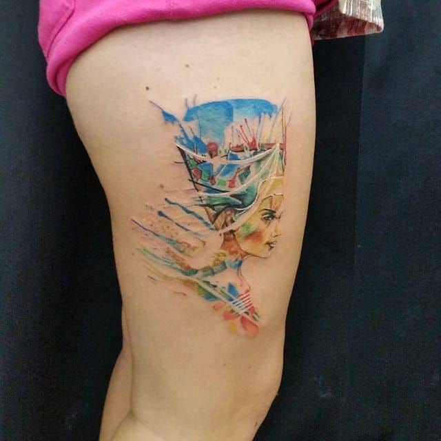 watercolor egyptian tattoo on thigh