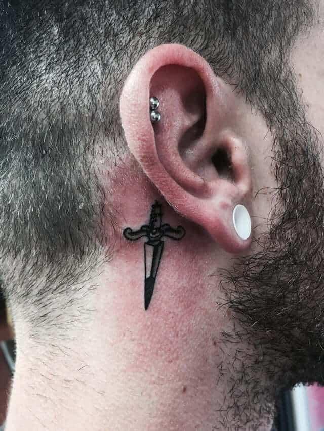 dagger ear tattoo