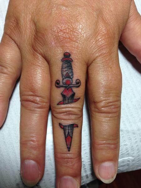 dagger finger tattoo