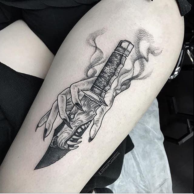 dagger thigh tattoo