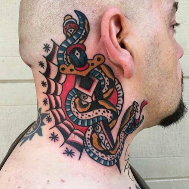 snake and dagger tattoo on neck