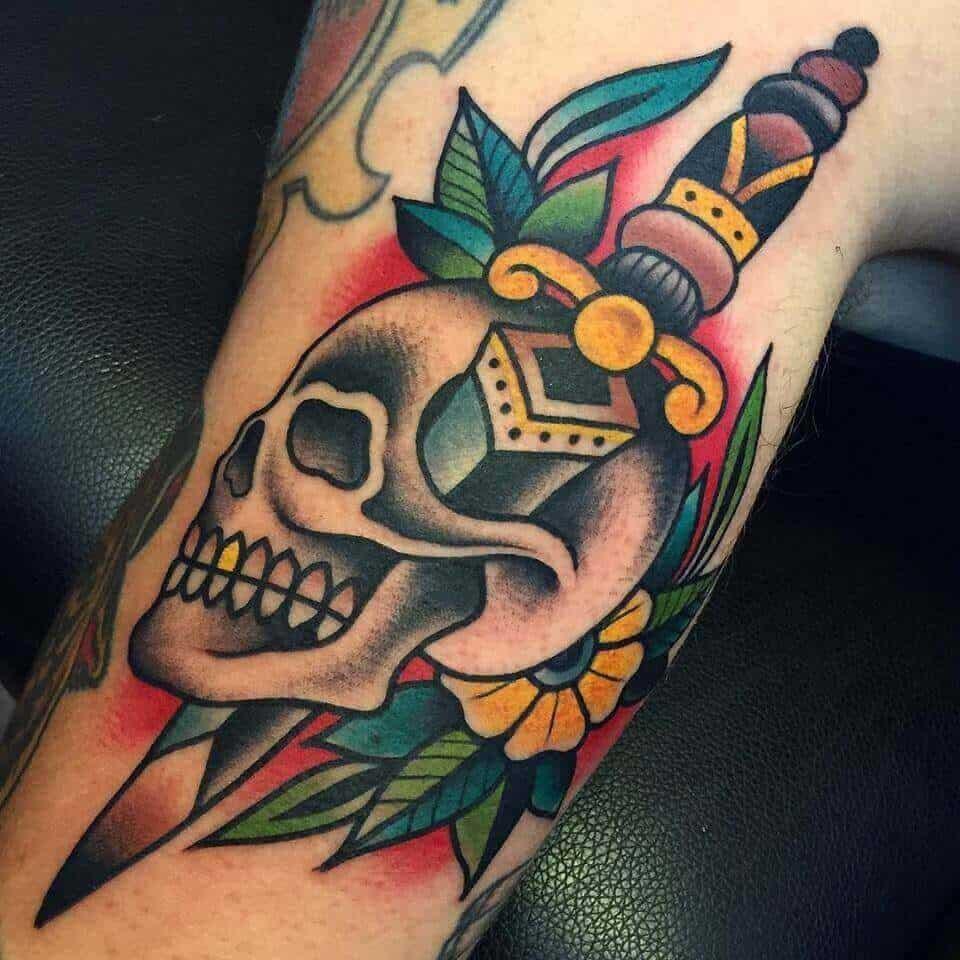 dagger tattoo on arm