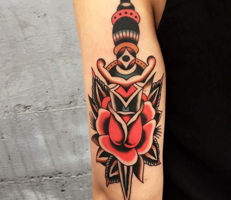 dagger arm tattoo