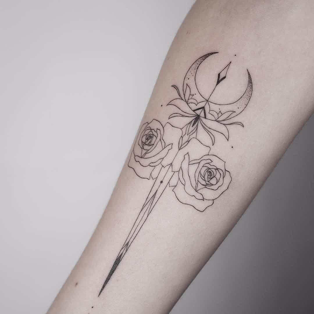 dagger tattoo on leg