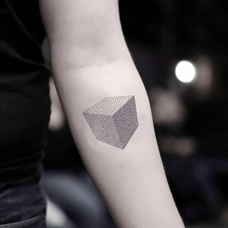 pointillism tattoo on arm